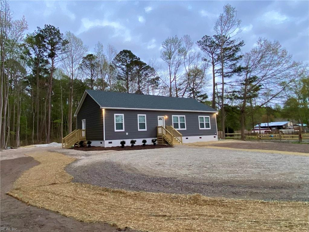 NEW CONSTRUCTION!! Modern Farmhouse on a 1-acre fenced lot in rural Grassfield! Upgrades include 9' ceilings throughout, all stainless kitchen package, low maintenance floors throughout, water treatment system. HUGE 20'x26' Detached garage with power! Horse Farm and wooded views give plenty of privacy on a low traffic street minutes to HWY 17. No deed restrictions! You will not find a better deal on new construction in this school district!