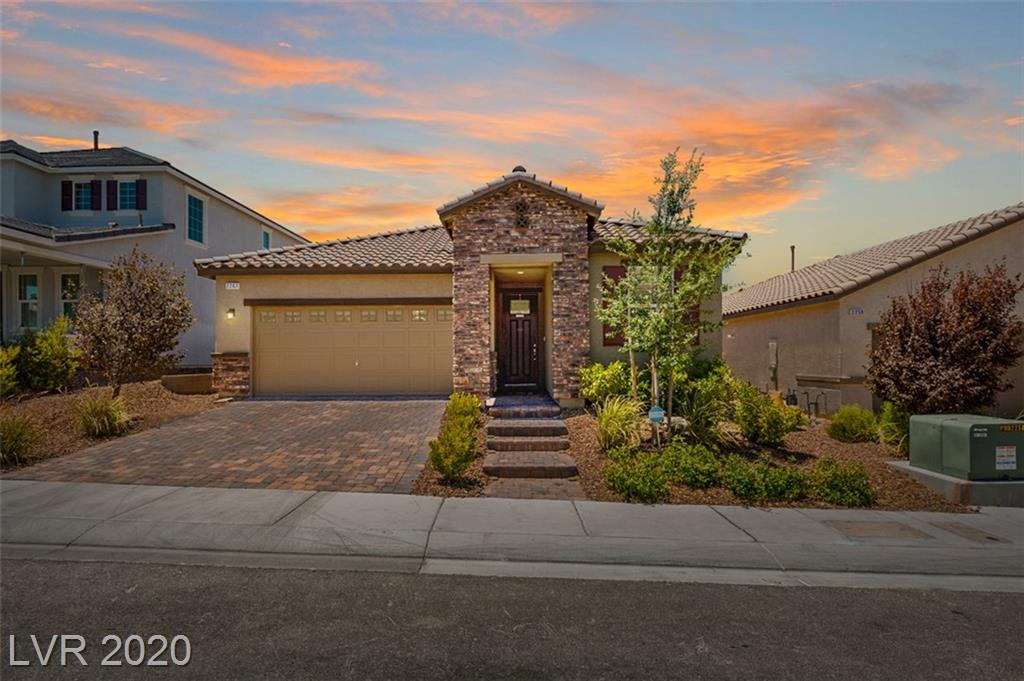 """Practically Brand New beautiful single story located in the amazing master planned community of Inspirada. This gorgeous home is completely private with nobody backed up behind. The sunsets from the covered patio are breathtaking! The oversized back yard is great for entertaining. The owners retreat has a large walk in closet and large walk-in shower. The kitchen has granite counter tops, pop out just off the kitchen ideal for formal dining or office area. You'll find two-tone paint, engineered tile floors throughout the main areas of the home, pavers in the driveway and walkway to the front door, highly upgraded soft water system and much more! 42"""" birch kitchen cabinets , 9' ceilings, 16 seer air conditioner, there are so many upgrades and you will love this home!"""