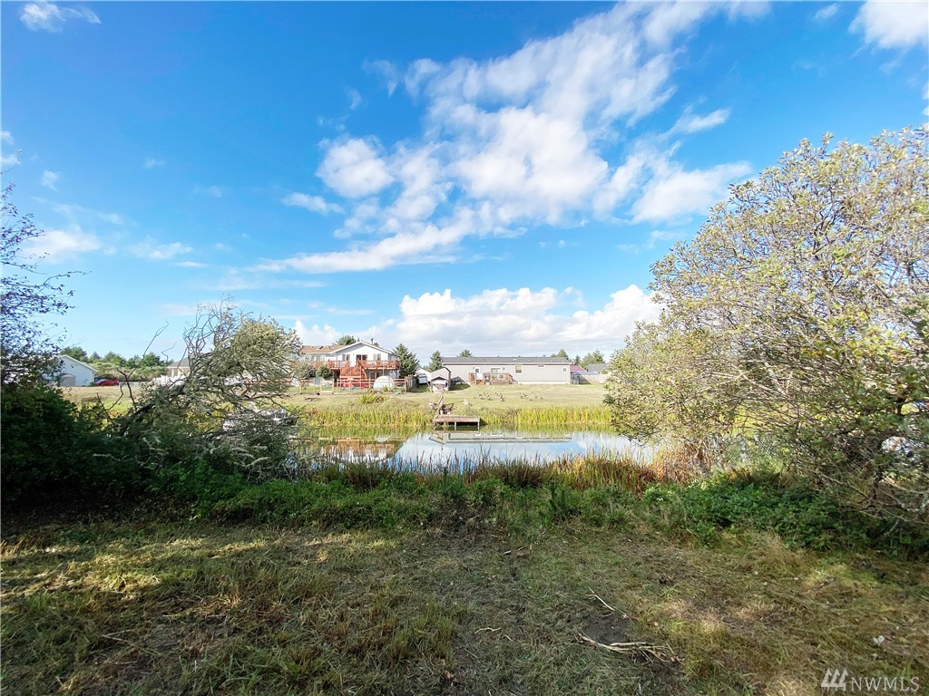 Beautiful waterfront land with water, sewer, power, telephone, and high speed cable internet in the street and ready for hook up.  Camp up to 90 days a year before you build. Build a dock and go fishing, kayaking, or swimming. Walk to the beach from this lot and go surfing.