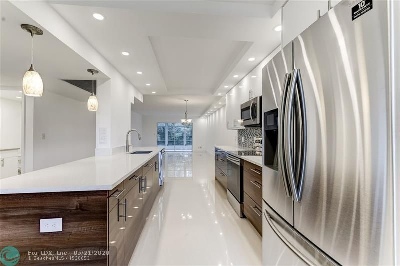 THIS IS A WOW, A PICTURE IS WORTH A THOUSAND WORDS, ONE OF A KIND TOTALLY NEW RE-DESIGN KITCHEN WITH TOP OF LINE RENOVATIONS, GREAT FOR ENTERTAINING.  CUSTOM LIGHTING THRU OUT, MAGNIFICENT FLOORING, BEAUTIFUL BATHROOMS WITH LOVELY SELECTION.  MOVE TO OUR AMAZING GOLF & TENNIS LIFESTYLE COMMUNITY AND ENJOY OUR EXCITING DAILY ACTIVITIES. JUST OPENED NEWLY RENOVATED BISTRO 18 SERVING 3 MEALS PER DAY, NEW PICKLE BALL COURTS. 1000 SEAT THEATER WITH LIVE SHOWS, MOVIES, OVER 150 CLUBS, 18 HEATED SWIMMING POOLS, CRAFTS, WOOD SHOP, DANCING, BUS SERVICE IN AND OUTSIDE COMMUNITY AND MUCH MORE. HURRY THIS BEAUTY WILL NOT LAST.  ASSOC REQUIRES 20% DOWN & 1 OCCUP 55+     ASSOC REQUIRES 20% DOWN & 21 OCCUP 55+