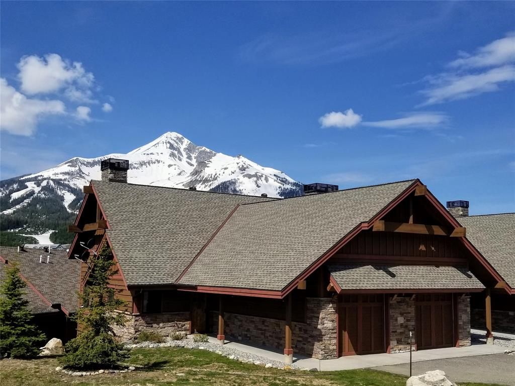 Desirable 2 BR/ 3BA Alpenglow Condominium in Big Sky's Mountain Village. End unit location with a spectacular unobstructed view to Lone Mountain, gourmet kitchen with stainless steel appliances, vaulted ceiling in the living room with rock gas fireplace, main level office/bonus room is furnished with a queen bed to sleep extra guests, deck with hot tub, owner lock off and heated garage. The unit is being sold comfortably designer furnished to sleep up to 8 guests. Convenient location and excellent rental income make this unit a wonderful mountain retreat. Free Shuttle Bus stop close by.