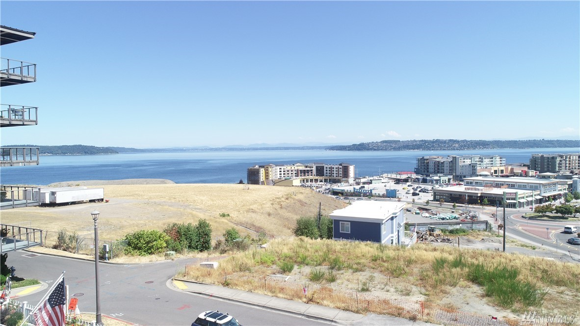 VIEWS VIEWS VIEWS. Great views of Sound, City views day and night, Point Ruston and Mount Rainier. Zoning allows for multi family and you can go vertical. Home is a 2 bedroom / 1 bathroom in good condition. Large front yard, property is 6000 sqft with alley access to the back of the home. Excellent location with walking distance to Point Ruston with lots of new restaurants, shops, new waterfront park / boardwalk underway and beaches for walking, biking and skating. Public water and sewer.