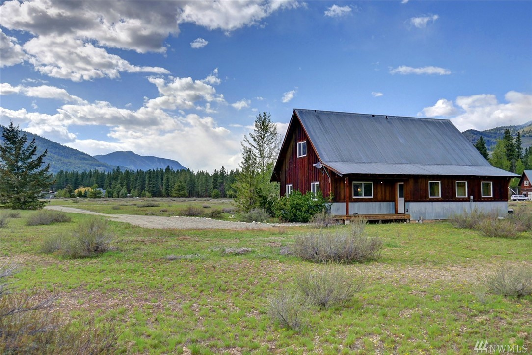 WOLF CREEK right on the ski trail! Classic Mazama corridor views and timeless construction in this 2038sf 3 bed home.  Exposed beam pine tongue and groove ceilings, open living area design, oak flooring refinished in 2018. Clean lines and natural light define this NW craftsman design. Master down and 2 bedrooms up with bonus family room, large slate mudroom for all the gear. Comes furnished to start playing right away.  New front deck, located on 2 acres of level usable land. Free trail passes!