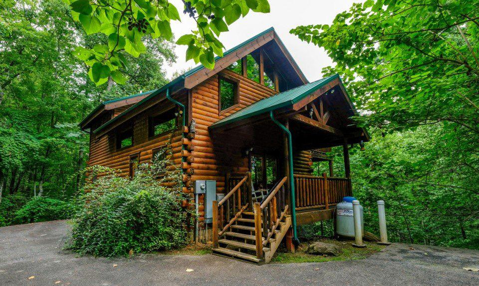 Tucked away on a 1.32 acre wooded lot bordering the Great Smoky Mountains National Park, this oasis of privacy offers stainless steel appliances, breakfast bar, hardwood floors, accent lighting & a unique sky walk/loft overlooking living area. All three large bedrooms offer access to one of three full length covered decks. Solid wood kitchen cabinets and accent lighting throughout. Loft features cathedral ceilings and a spacious sitting area. Downstairs you will find a large recreation room with recessed lighting and deck access out to the hot tub. Open floorplan and lots of windows make this roomy cabin an easy place to enjoy. This home has $62,894 of rental income on the books for 2021, and produced $48,346 in 2020. Privacy, amenities & plenty of space, it has it all. All this and it's only a mile to downtown Gatlinburg, or you can walk to town through the park on Cove Mountain trail! If you want a true Mountain get away, this is it!
