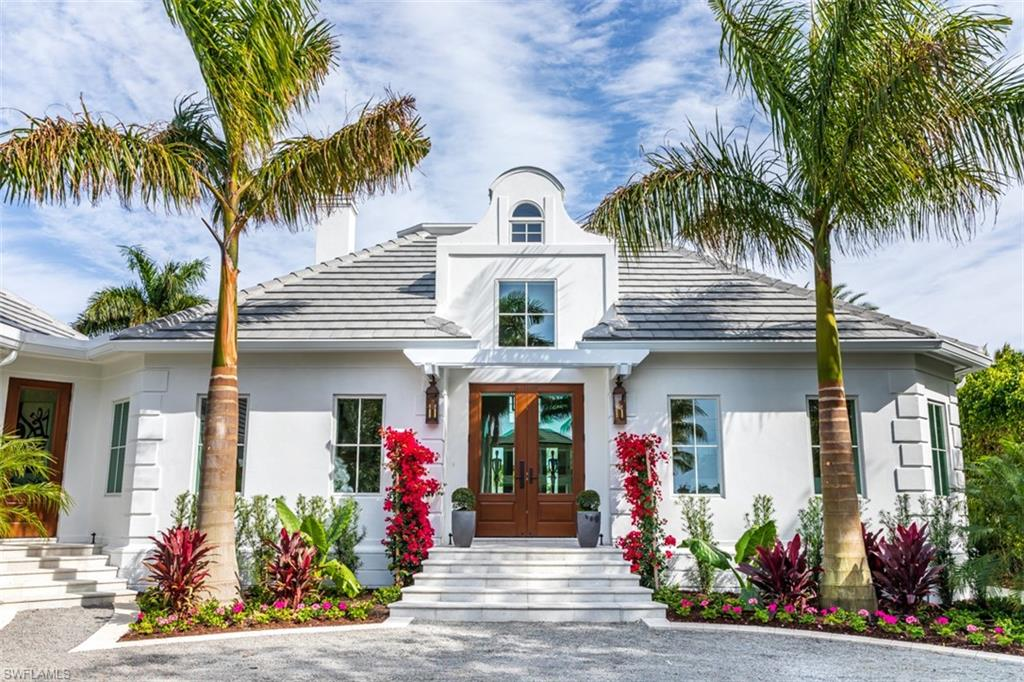 Every buyer's dream! Port Royal's newest gated jewel is located on one of the most coveted streets and waterways in Naples. Remastered in a down-to-the-studs transformation by Oakley Home Builders. The apex of today's luxury living is expressed in couture finishes, soaring ceilings, indoor/outdoor living, a large working library, ensuite bedrooms and an open kitchen and family room. From the gallery, you are ushered inside as your eyes are drawn towards views of Runaway Bay and wide waterways. The great room folds into a large loggia with a fire feature and overlooks a magnificent outdoor entertainment area with pool, spa and dock. Whitewashed and parapet walls create the ambiance of a coastal paradise and tantalize the senses. New everything - roof, windows, mechanical systems and doors - plus eligibility for Port Royal Club membership.