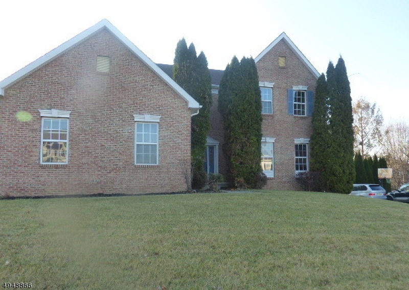 Large brick colonial with large family room, 2 story ceiling and stone fireplace. Eat in kitchen new appliances with door leading to deck, great for entertaining. Hardwood floor  throughout main level. First floor master bedroom with soaking tub. Full finished basement, rec room and office and additional full bath. Sold AS IS condition, seller will not complete any repairs to the subject, either lender or buyer requested. First look expires on Dec. 26, 2019 only owner occupant offers will be considered during this time.  Close to all amenities and commuting arteries.