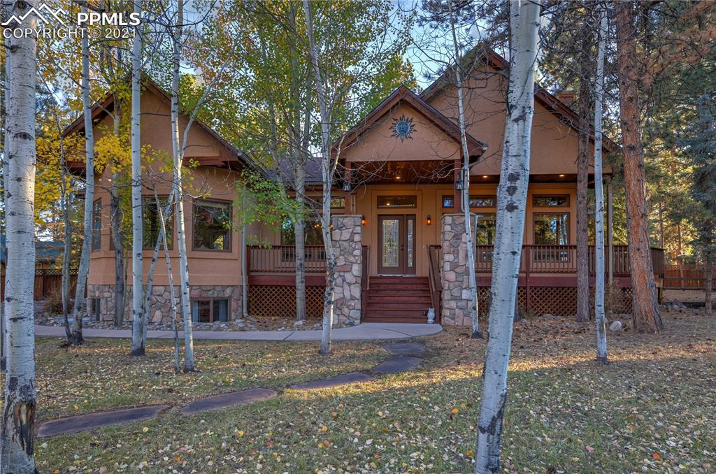 Beautiful, sunny mountain home located on a private cul de sac in a desirable golf course neighborhood! The exterior blends stucco, wood, and stone for a woodsy feel. Custom flagstone path leads through a picturesque aspen grove to a covered front porch and wrap around wood deck. The front entry welcomes you into the spacious main level living area with large windows, vaulted ceilings, and a floor to ceiling gas fireplace with rustic stone surround.  Hardwood flooring throughout the entry, formal dining room, and kitchen. With its multiple windows and open feel, the kitchen invites any home chef to test their skills. It also features a breakfast nook, entertaining bar, granite countertops, tile backsplash, a natural gas range, and stainless steel appliances. Walking into your master bedroom, you'll find gorgeous bay windows, a walk-in closet, standing shower, jetted soaking tub, and double vanity. The main level features an additional walk out bedroom, great for an office or guest room. Main level living features a large laundry with built in cabinets and ample storage in the linen closet. Going down the stairs, you'll find a huge lower level living area, great for the everyday entertainer. If your guests need a place to crash, then the 3 bedrooms and 2 full baths will easily accommodate them. You'll never outgrow this home, with plenty of room to expand, and a closet currently plumbed to add an additional bathroom. The large, lovingly cared for backyard is your own mountain oasis featuring mature pine trees, a privacy fence, and multilevel decks great for outdoor grilling, dining, and your hot tub!  A large 3 car garage, on-site storage container, and shed offer great storage space for any toy collector. Front landscape has been expertly refreshed to match the feel of the neighborhood. Situated in a friendly community with no HOA, come by and see why this lovely house needs to be the place you call home!