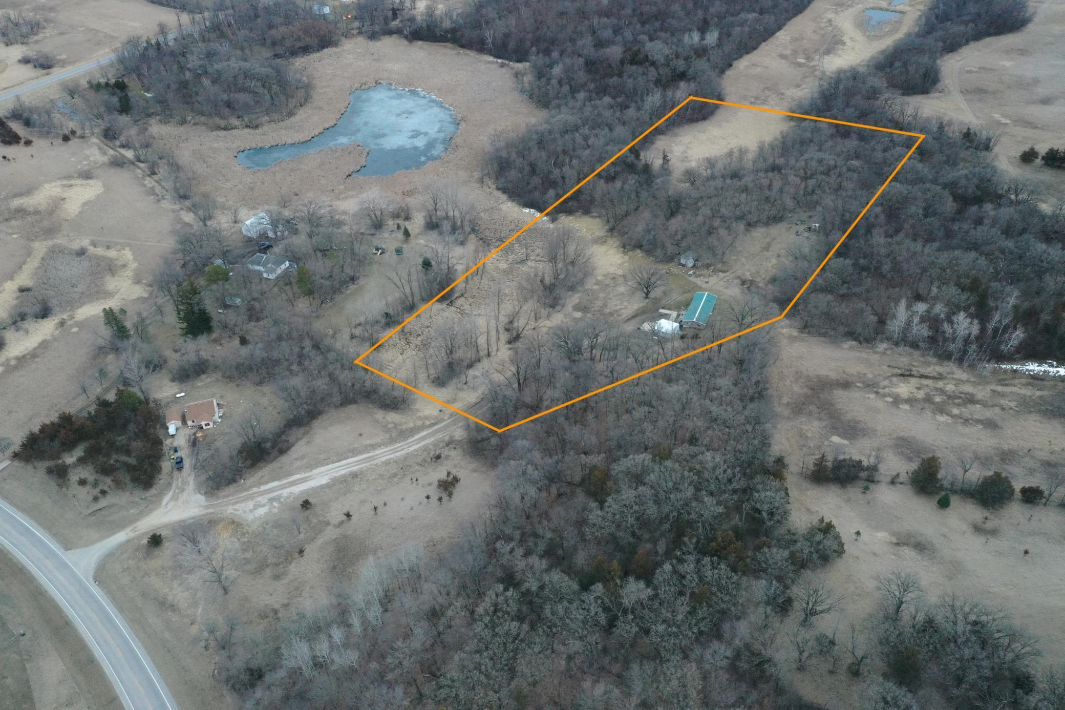 Glacial Ridge Acres along The old Irving road. Long Driveway to your private place in the county. Build or nestle into the OLD doublewide. You will love the topography out here. Nice Sunrise views over a wetland. Sufficient hunting with successful Turkey and Trophy Whitetail harvested from this parcel. Tenant occupied 24 hours to show. Seller intends to complete a 1031 exchange as a result of this sale.