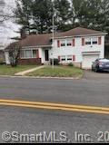 Well maintained home with possible in-law. Natural Gas, City Water and Sewer. Home centrally located - great for commuting and bus routes. All appliances in as-is condition. Don't miss viewing!
