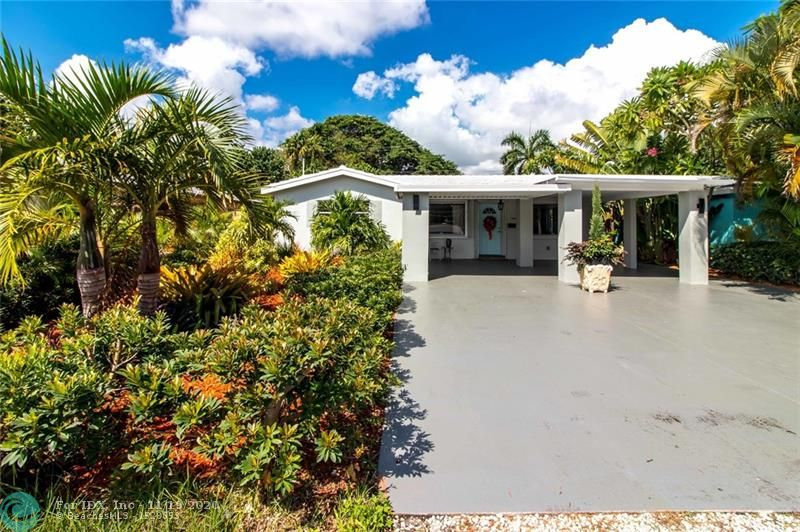 Walk to Wilton Drive, Great location, 2 bedroom 2 bathroom home on well landscaped lot. (plenty of room for a pool) Bahama tile roof, new AC 2015, New Electric 2015, new appliances 2015, updated kitchen and bathrooms, impact windows / shutters on entire house. 2 car carport, insulated attic 2015, new landscaping, freshly painted and ready for immediate occupancy. fenced yard, large driveway, new irrigation lines 2015.