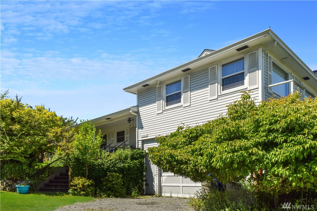 Outstanding views of Seattle, Puget Sound, Cascades and Olympics from this generous sized North end home. Large lot has mature fruit trees and privacy on a quiet lane. This multi story home features 4 bedrooms, 3 bathrooms, nice deck off the dining room, covered porches on 2 sides and a large basement/storage workshop. All this only minutes from the Vashon ferry dock to West Seattle and Downtown Seattle. Imagine the possibilities.