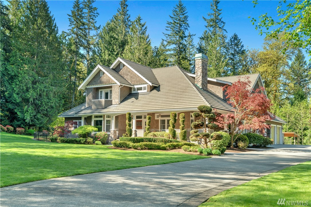 Luxury on 5 acre estate conveniently located in Woodinville's Bear Creek! This meticulously cared for classic craftsman home boasts soaring ceilings, large open spaces & oversized windows. Beautifully appointed interior features expansive wood beams, heated floors,  granite counters, slate tile & stunning custom millwork. Watch movies in the theater, compose in the music room or use the gym w/ private sauna. Outside find a large covered patio, sports court and play structure plus 4 car garage.