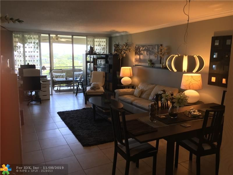 Remodeled 2 bed/2 bath condo in popular Palm Aire. Updated kitchen & bathrooms. Kitchen features recessed lights, white appliances, granite countertops, dishwasher & built-in microwave. Double French Doors open to 2nd bedroom. Guest bath features step-in shower. Sliding glass doors in main living area allows access to beautiful screened-in balcony w/ views of the lake. Tile & wood-laminate floors throughout. Assigned parking. On-site laundry just a few steps away. Community pool & community room located within walking distance from condo. Palm Aire is lushly landscaped & offers great curb appeal. Cats allowed. Condo currently rented through Dec. 31, 2019. The best of South Florida living! Located close to shopping & Turnpike. 20% down required.