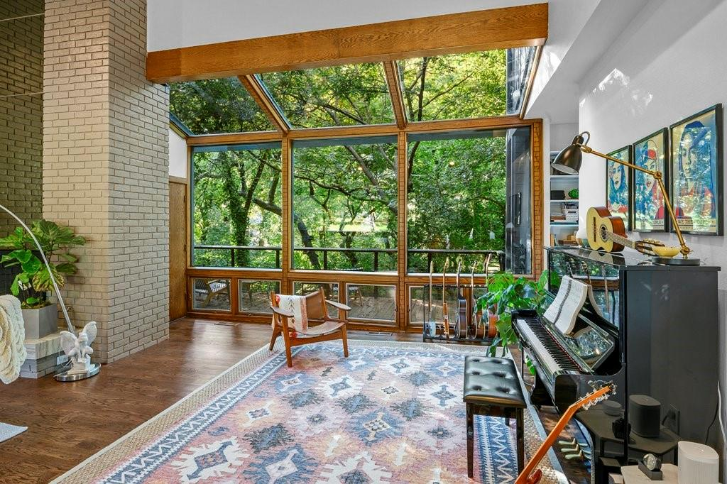 Iconic, mid-century modern treehouse nestled among many trees towering 35 feet above the creek bed! This stunning custom home was previously owned and built by local architect, David Ludwick and later renovated in 2017 by Eddie Maestri, architect, and Jim Scott & Sons, builder.