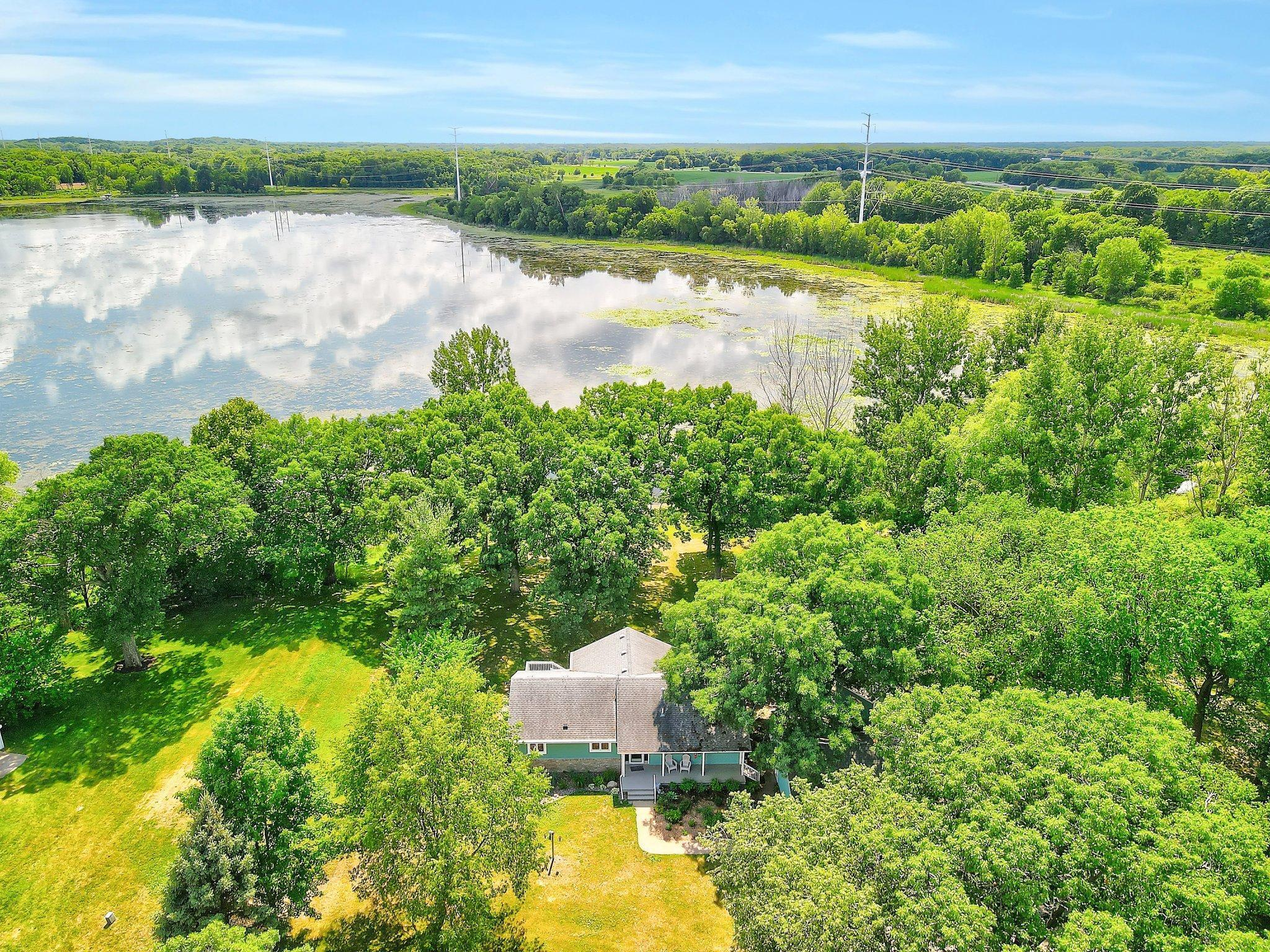 Welcome to your own private retreat on Green Lake with 2.5 acres and over 450' of lake shore, gently sloped from the house to the lake.  Wonderful front porch, 3 season porch, deck and new windows to appreciate nature views.  Main floor bedroom with private bath, living room, new custom kitchen, informal & formal dining, family room & 1/2 bath.  Walk-out level features 2 bedrooms, family room, office, 2nd kitchen, den, & laundry/mechanical room.  Lots of recent updates including:  3rd bedroom, new septic mound, air-conditioner, furnace, plumbing, shower, patio, shed, gutter covers, flooring, landscaping & more. Private road accessible by appointment only.