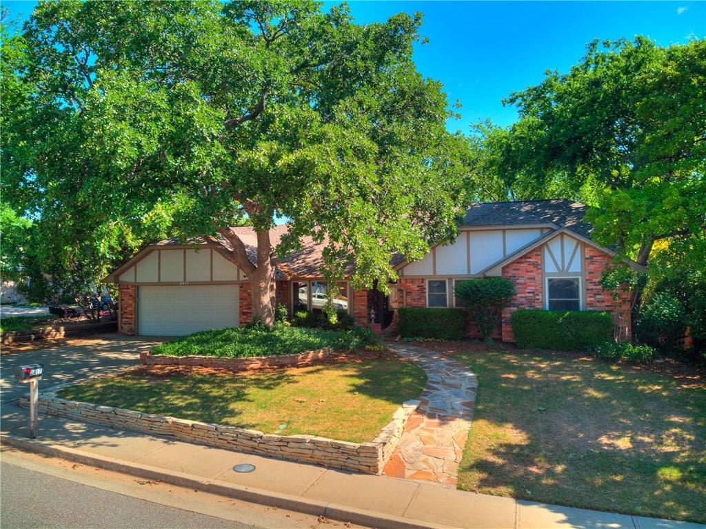 Pride of ownership here! This beautiful spacious home boasts of 5 bedrooms which includes  a mother-n-law plan that has a living space (could be used for a game room), a bedroom (could be an office) with a walk in closet that is a SAFE ROOM, and large bathroom (that's handicapped accessible) with a huge walk in shower, all beds have walk in closets, 2 coat closets, built in china cabinet. Lots of storage! Updated kitchen with granite counter tops, brand new SS appliances, all the cabinets have pull out drawers, laminate flooring, brand new carpet in all the bedrooms, freshly painted inside, gas fireplace, new roof in April 2020! Beautifully  landscaped yard is your own private oasis with a waterfall. This home is located in the desirable Chimney Hill addition with large trees, 2 swimming pools, tennis court, basket ball hoop and a walkway right into Hafer Park.  Located close to schools, shopping, higways and the turnpike!  Your buyers don't want to miss this one!!!