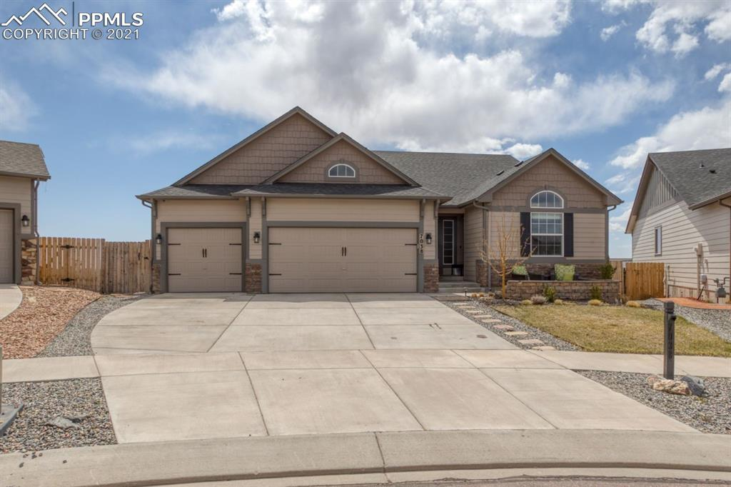 Don't miss this gorgeous 4 bedroom ranch style home in Indigo Ranch!  This home has it all!  Amazing wide open floor plan, quartz counter tops, master bedroom that walks out to the deck with views for miles.  The master closet even attaches directly to the laundry room!  Entertain in the huge downstairs family room, deck or patio.  This home shows like a model, Hurry and make it yours!