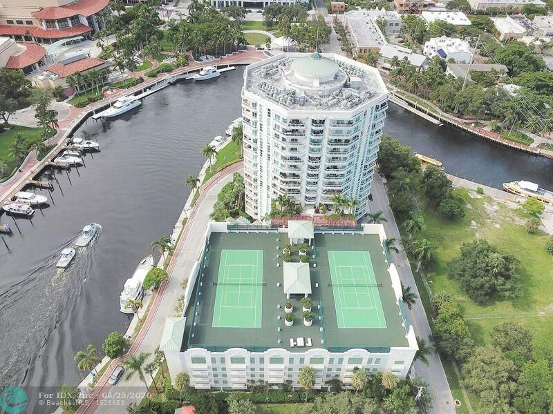 SPECTACULAR VIEWS OF THE NEW RIVER AND ALL OF DOWNTOWN FORT LAUDERDALE!  A 3/2 CONDO CONVERTED TO A 2/2 CREATING A HUGE GREAT ROOM WITH PANORAMIC VIEWS AND LOTS OF LIGHT!  TRAVERTINE FLOORS IN ALL THE LIVING AREAS.  MASTER BATH W/DOUBLE VANITY SINKS, JACUZZI TUB AND LARGE SHOWER.  THIS UNIT IS HIGHLY CUSTOMIZED WITH CROWN MOLDING, CUSTOM SOFFITS WITH LIGHTS AND BUILT-INS IN MASTER CLOSET.  UPGRADED KITCHEN AND STORAGE UNIT ALL ENHANCE THIS CONDO.  WALK OR TAKE FREE WATER TROLLEY TO PERFORMING ARTS, LAS OLAS AND HIMMARSHEE.  UPSCALE BUILDING W/ALL THE AMENITIES INCLUDING STATE OF THE ART FITNESS, TENNIS & PICKLE BALL COURTS, BUSINESS CENTER, SOCIAL ROOM, HEATED POOL & HOT TUB.  TWO SIDE BY SIDE PARKING SPACES INCLUDED.