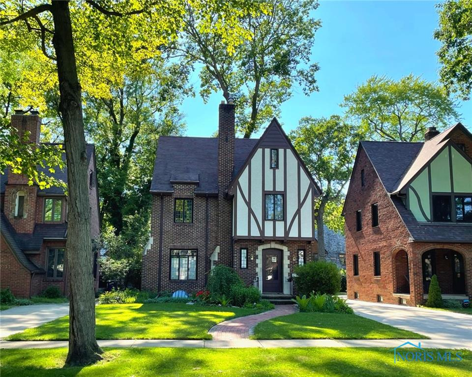 Brick Tudor full of charm and character. Leaded and stained-glass windows, and hardwood floors underneath carpet. Living room with fireplace. Kitchen with hardwood floors and breakfast room with French doors open to enclosed porch that overlooks private garden and limestone patio. 4 upper bedrooms including tiled master suite with dual closets and window nook. Additional full tiled bath with pedestal sink up. Third floor completely finished as a rec/bonus room with rich woodwork and skylights. Lower level with plenty of storage and finished family room with tiled floors and fireplace.