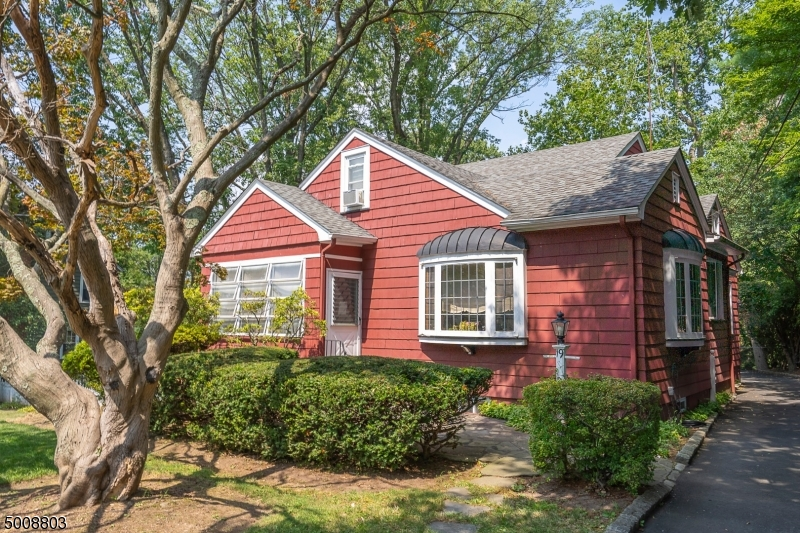 "This charming ""Red Cottage"" offers the ideal palette for the buyer with a decorating flair. With opportunity galore, this 4 BR Colonial has the potential to be the most darling home!  3 season porch is the ideal entrance to the formal Living rm w/ lead glass windows & WBFP. Easy flow to spacious Dining room & eat-in-kitchen. Master BR suite w/ sitting room/office & full bath, additional BR and main hall bath.  Upstairs you will find 2 good sized BRs, office & full bath. Hardwood floors, & beautiful details throughout.  Unfinished lower level w/ laundry & plenty of storage. Situated on a lush, level double lot w/ over sized 2-car garage featuring large loft space ideal for studio/home office.  Located within minutes from NYC direct trains, town, parks & schools. Being sold strictly ""as is."""