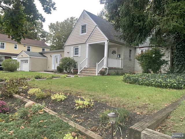 FABULOUS 4BR/2.5BTH HOME WITH APPROXIMATELY 2,100 SQ.FT. OF COMFORTABLE LIVING SPACE LOCATED IN ONE OF THE MOST SOUGHT AFTER NEIGHTBORHOODS OF BERGENFIELD! FIRST FLOOR FEATURES A GOOD SIZED ENTRY FOYER/MUD ROOM, SPECTACULAR LIVING ROOM WITH BEAMED CATHEDRAL CEILING,RECESSED LIGHTING, LARGE WOOD BURNING FIREPLACE & BAY WINDOW FACING EAST, 2 BEDROOMS, OFFICE/BEDROOM, UPDATED KITCHEN WITH STAINLESS STEEL APPLIANCES,FORMAL DINING AREA, RENOVATED FULL BATHROOM, FAMILY ROOM WITH SLIDING GLASS DOOR LEADING TO THE BACKYARD WITH LARGE INGROUND HEATED POOL. SECOND FLOOR HAS A PRIMARY SUITE WITH SITTING AREA, HUGE WALK IN CLOSET AND FULL BATH. BASEMENT IS FULLY FINISHED WITH LAUNDRY ROOM, 1/2 BATH & TONS OF STORAGE SPACE. CENTRAL AIR CONDITIONING, MULTI ZONE BASEBOARD HEATING, MINUTES FROM SCHOOLS, DOWNTOWN SHOPPING, BEAUTIFUL COOPER'S POND PARK, PUBLIC TRANSPORTATION TO NYC & HOUSES OF WORSHIP. A MUST SEE!!!