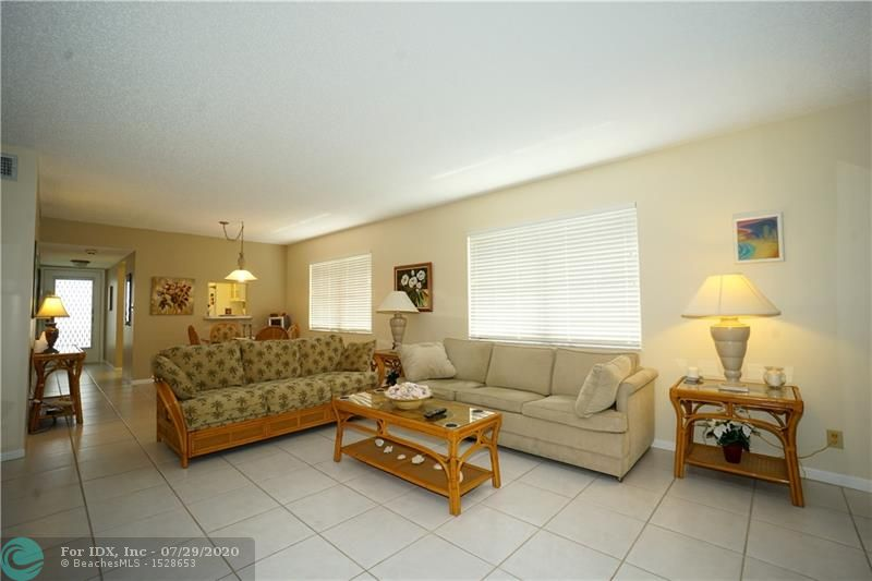 Canal front condo and corner unit... In top condition with plenty of light and views.  Fully furnished and in turnkey condition. Gated 55+ community. This is the larger 2 bedroom model. Washer dryer in the unit.