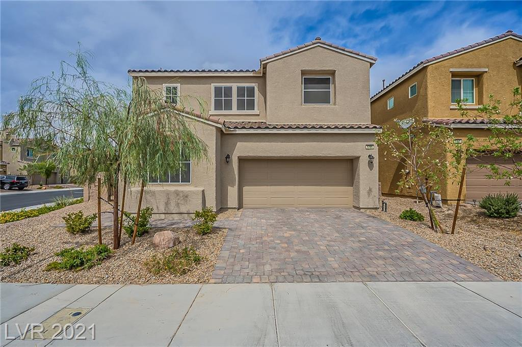 Built in 2019, this North Las Vegas two-story home offers granite countertops, and a two-car garage.