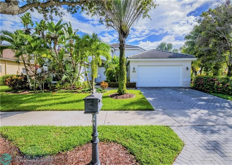 Enjoy the country club lifestyle in South Florida's premier community, Weston Hills! Beautiful 5BD/3BA single story w/gorgeous curb appeal, over 1/4 acre private fenced & hedged corner lot w/HEATED POOL & generous covered screened patio, perfect for year-round comfort. Freshly painted inside/out, this light, airy home has a spacious 3-split floor plan & cabana bath. Master Suite w/hardwood floors, travertine bathroom; all other bedrooms have new wood laminate flrs. WHITE kitchen w/granite, stainless appliances, including new dishwasher, microwave & washing machine. California closets, newer AC w/UV lights, new remote ceiling fans in Fam Rm & patio, ACCORDION shutters, security cameras, outdoor landscape lighting, new LED lighting. Home warranty included! Golf around the corner! A+ schools!