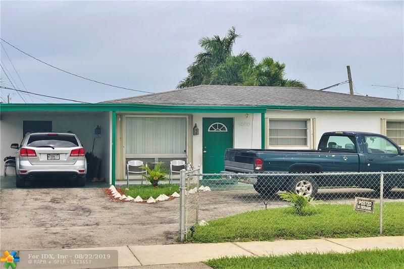 Charming home just North of the Swap Shop on Sunrise blvd.  Updated Nice kitchen with ample counter space. Large fenced in backyard for entertaining, or pets.  1 car carport.  Florida Room on the back overlooking the yard.  Quiet neighborhood in convenient location.   Hurry this one will move fast