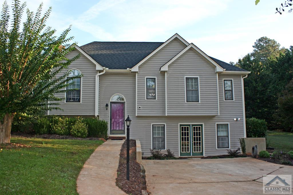 Welcome to this 3 Bedroom, 3 Bath Oconee Home. All bedrooms are on the main level, with a split bedroom plan. In the basement, it features a media room (projector doesn't remain), and 3 other finished rooms that can be used as storage, offices/studies. There has ample parking on this 1.51 acre lot that also features a 30x40 metal shop with a half bath and garage door and 24x34 carport. This place is a must see!