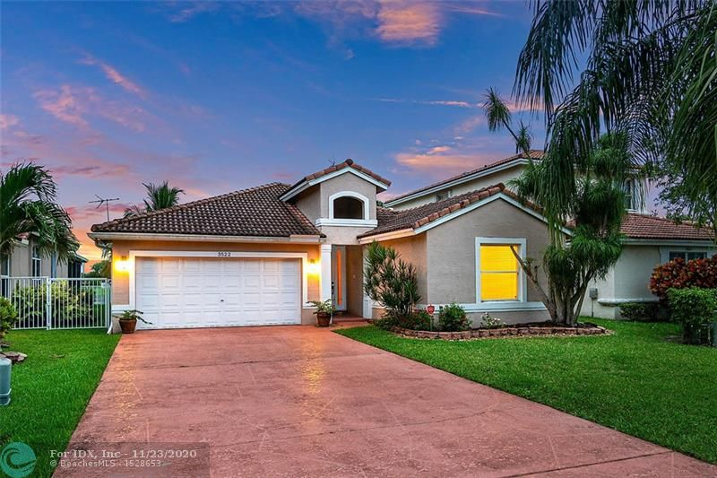Enjoy stunning sunsets in this tastefully done 3 bedroom, 2 bath home overlooking beautiful Coco Lake. Home features granite countertops, oversized driveway and custom closets. Low HOA includes lawn maintenance, tree trimming, and community pool. Centrally located near highways, shops, restaurants and walking distance to community park. Don't miss out on this fabulous opportunity!