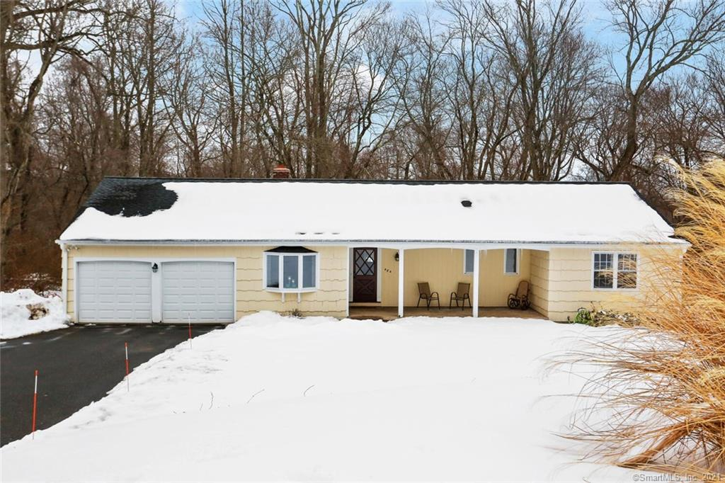 """Nestled on a quiet street in a coveted Fairfield neighborhood is 484 Surrey Lane, an immaculate home with a picturesque yard & desirable features throughout. A charming front porch invites you in where you are greeted by a foyer, hardwood floors, sun-lit rooms, a great floor plan & incredible views of the backyard. The brick fireplace in the living room warms up the space & glass sliders to the deck make for easy entertaining! The brick wall continues through to the eat-in kitchen where you'll find a breakfast nook, SS appliances, a workstation, pantry, glass sliders to the deck & access to spacious dining room. On the South end of the home, 3 generously sized bedrooms & 2 full baths await, including the master bedroom suite. The desirable features don't end there – take a peek at the lower level! The family room is anchored by a stone fireplace & is the perfect spot for movie nights, a kids hangout spot or a """"man cave,"""" with sliders to the backyard making indoor-outdoor entertaining oh so easy. A half bath, laundry room, office & gym complete this level. Greenfield Hill is known for expansive lots & a tranquil ambiance & 484 Surrey Lane checks all the boxes. Enjoy relaxing on your deck overlooking your 1.6 acres of private, treed land. This home is conveniently located minutes to downtown Fairfield, the Merritt, I-95, schools, parks, restaurants & beaches...everything is at your fingertips yet it's the perfect oasis away from the hustle & bustle of our busy lives!"""