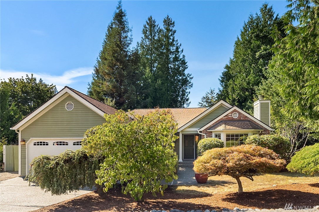 An adorable rambler on a large corner lot in The Woods in Issaquah! Updated furnace with A/C, tank-less water heater, new garage door, interior paint & carpet. Huge master with 2 more spacious bedrooms, bright living room & cozy family room with gas fireplaces. Delightful, fully fenced backyard with trellis, fruit trees & excellent privacy. Just a moments walk to Tibbetts Park, Issaquah P&R & shopping center. One of the most desirable neighborhoods in Issaquah, you'll surely love where you live!