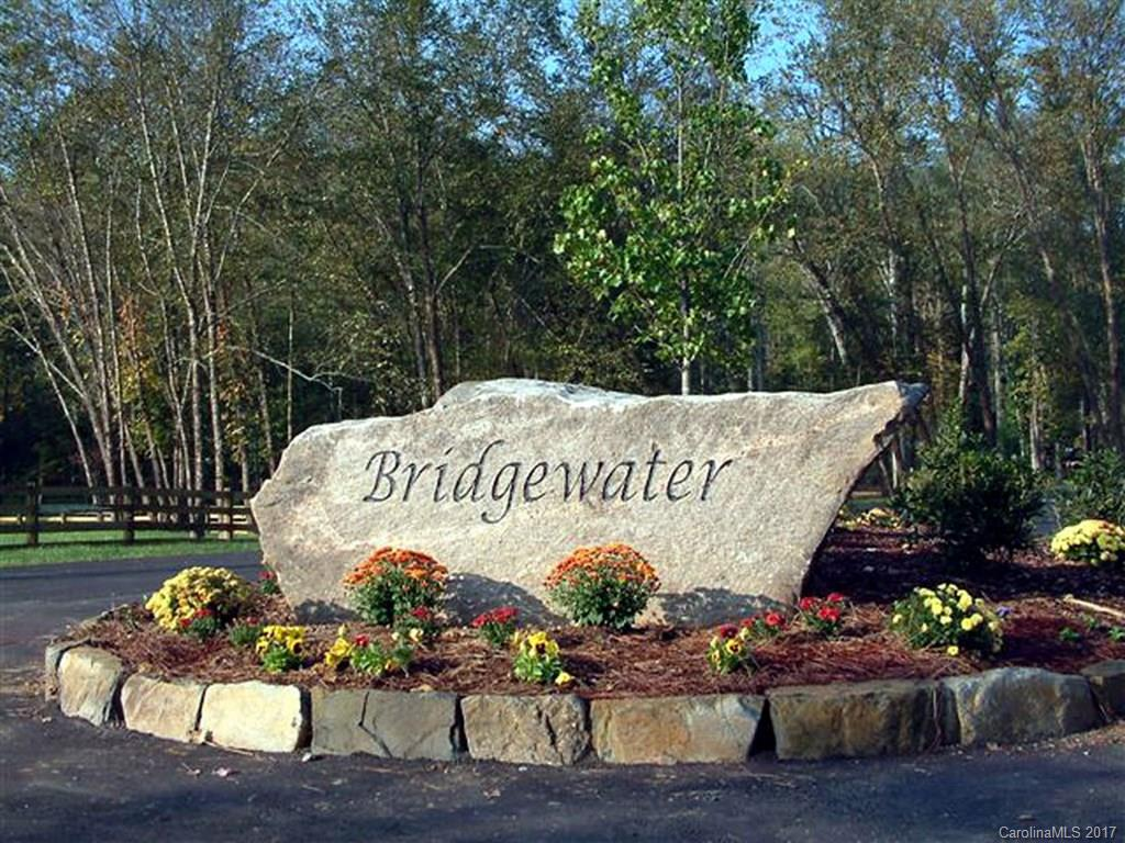 """Super easy building lot in premier gated community of Bridgewater. Minutes to down town Asheville this lot is situated adjacent to """"Bridgewater Green"""" a 1/2 acre park providing plenty of green space to roam around. Lot is set up for crawl space. All underground utilities and amenities in place. Community has 3 park, abundant walking trails and community pavilion."""