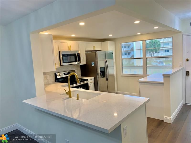 This 2 bed 2 Bath fully renovated unit has everything you need.  This unit lies in the perfect location just 6 miles from Deerfield Beach, 1.4 miles from the Coconut Creek Promendade for dinning, shopping, and movie theatres.  Less than 3 miles from the Coconut Creek Seminole Casino. Less than 25 minutes to the Fort Lauderdale International Airport and conveniently located just off the Lyons Rd. entrance into your new home in the Wynmoor community.  It is a beautifully landscaped, safe, and friendly community to live in.  Whether you are looking for an active community or just the serenity of your own home with a water view- stop searching and come check out your new home!  Features quarts counter tops in kitchen and bathrooms, new stainless steel appliances, new floors, cabinets, fans etc