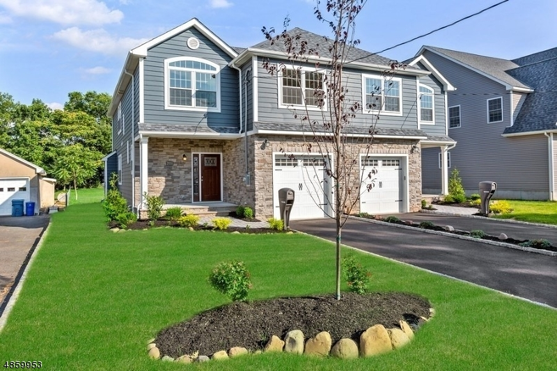 Welcome to this Duplex Style Townhome! Built in 2018. It's Open & Bright  with a Large Eat in Kitchen. Plenty of Cabinets, Granite  Counter Tops & SS Appliances. Living Room w/Gas Fireplace opens to Formal Dining Area. A Laundry Room & Half Bath complete the first floor. Second Floor offers, Master Bedroom w/Double Walk-in Closets, the Master Bath features Double Vanity, Shower Stall & extra Linen Closet. There are three additional Ample size Bedrooms and Full Bath. A 400sq ft. Finished Basement with half bath is an added Space for Entertaining. A 12 x 12 Deck off the kitchen overlooks an expansive Backyard so you can enjoy plenty of outdoor space. This home is move in ready, a must see.