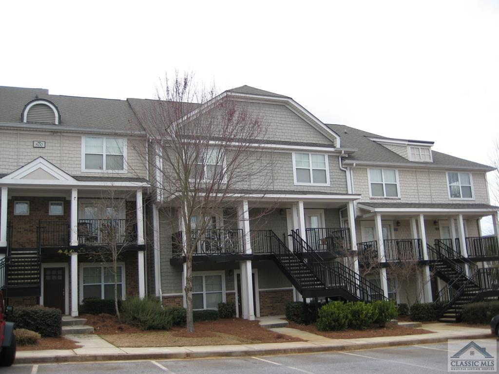 Nice 2 BR/2.5 BA TH style condo in gated student community.  Laminate floors on main level.  Main level has 1/2 bath, dining area and nice kitchen.   Upstairs has 2 BR's with private baths.  HVAC has been replaced April/2020. Condo is leased through July, 2022. Current lease is 950 through July, 2021, and Fall lease Aug-July, 2022, is 1100/month.  Managed by on site management company.  Resort style community featuring clubhouse, pool, tennis/basketball/sand volleyball courts.  Great opportunity for investor purchase or a parent buyer for August, 2022.    Note:  photos of unit are without tenant furniture.
