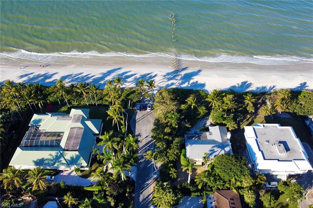 Rare opportunity to own one of the few remaining true beachfront cottages in one of Naples' most desirable locations. This spacious, quaint cottage sits directly on the beach and offers 2,400 square feet of living, including 4 bedrooms, 4 bathrooms, a vaulted ceiling character family room, a two-car garage and a whole house generator. 1 3rd Ave South is a prized location, close to 5th Avenue South restaurants and shops but just far enough away, making the area and beach quiet with a private feel. With 100 feet of beach frontage and 174 feet deep, this is a perfect cottage for enjoying the casual, laid-back beach lifestyle of the Gulf of Mexico or an opportunity to build your beachfront dream home.