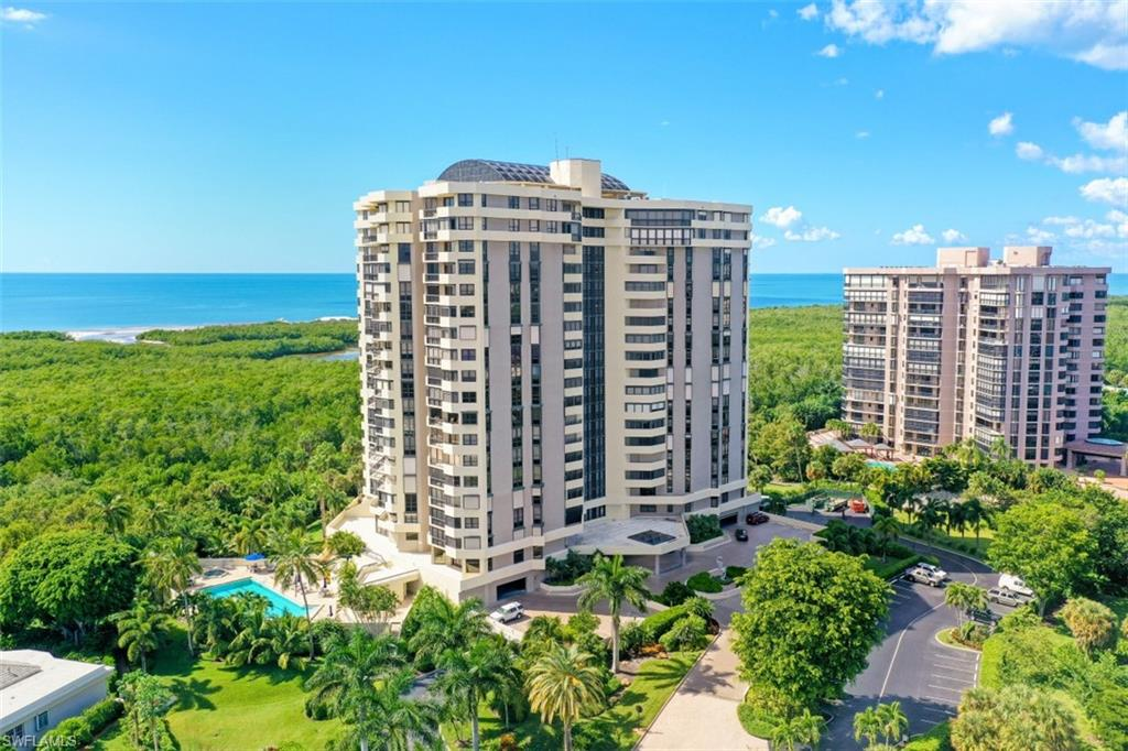 C3679 - Stunning SW views of the Gulf of Mexico can be seen from every room of this 14th floor, 2 bedroom 2-1/2 bath unit.  No buildings to block the view.  The split bedroom floorplan with ensuite bathrooms and slides gives a total sense of privacy.  The master bathroom has been totally redesigned with a large shower and dual sinks with plenty of storage.  The master closets are large and have closet organizers.  Both bedrooms and living area have wood floors.  The kitchen has stainless steel appliances, granite countertops and a window with a view! Windows and sliders have been replaced with hurricane rated windows except one in the master bedroom.  Grosvenor is a short walk or car ride to the south beach club and pavillion.  Pelican Bay offers 2 private beach clubs, two restaurants, complimentary chair and umbrella service, community center that has a state of the art fitness center, spa, 28 Har-Tru tennis courts and sidewalks and bike paths throughout.  Enjoy the view, and the amenities of the building, including the pool, fitness center and community room.  Enjoy Pelican  Bay and all that it has to offer.