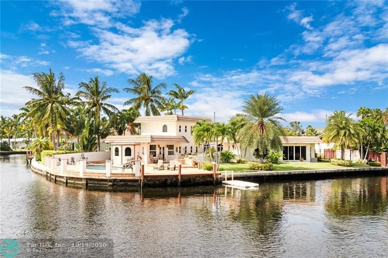 Impressive Waterfront Point Lot on the North Fork of the Middle River. Tucked away at the end on a quiet cul-de-sac street with Stunning Sunrise, Sunset & Water Views. Upon entering, you're greeted by a Dramatic 2 story Foyer, Wraparound Stairs and & Spectacular Rotunda. Split level floor plan. HUGE Gourmet Kitchen with open concept Florida Rm, Dining Room & Breakfast table which all over look the Water!  Over-sized En-Suite Master on the 1st Floor, 2 Bedrooms Upstairs with Wood Floors. Recent updates include: Kitchen, Bathrooms, Impact Windows / Doors, Roof & a Heated Salt Water Pool surrounded by Gorgeous Travertine Pavers, complete with a Fire Pit, Plenty of Outdoor Seating plus a Boat Dock & Jet Ski Lift.  2 Car Garage.  Perfect entertaining home. 3D Video available, a must see..