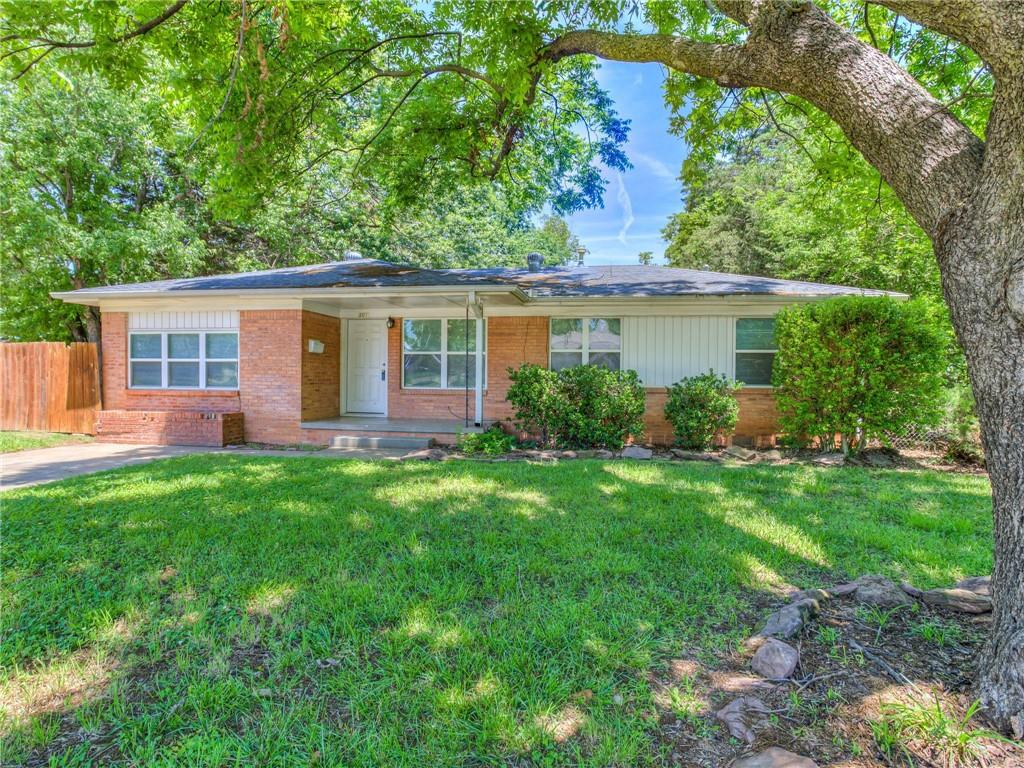 Check out this charming and updated mid-century modern home that is just blocks from OU campus!  This home features 2 living areas as well as beautiful, original hard wood floors.  In the last 10/11 years the majority of the electrical, plumbing, AC and windows have been updated or replaced.  Kitchen has updated gorgeous backspash with a stainless steel gas stove.  Washer, dryer and refrigerator are negotiable.  Great corner lot with large mature trees and an oversized concrete patio in the backyard that is perfect for entertaining.  There is also drive in access to the backyard.