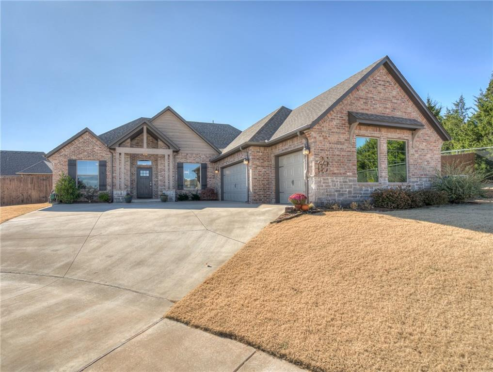 Inviting home on an oversized cul-de-sac lot in Rushbrook! Features and style abound in this gorgeous home! Past the stately front porch, be welcomed by the foyer with surrounding study & dining area. Spacious living room offers a fireplace, tile flooring, & natural light floods through picture windows to brighten the home.  A well appointed kitchen contains abundant cabinets, walk in pantry with a barn door, breakfast bar and, tons of delightful details such as quartz counters and designer fixtures. Relax to your master suite with tray ceiling, dual vanity, jetted tub, and  tile shower. Wood flooring in the study and the master bedroom. Enjoy your morning coffee or watch kids play from your covered patio. 3 car garage & wrap-around driveway. Storm shelter in the garage. Distinctive style and designer touches throughout. Community pool and park. Welcome Home!