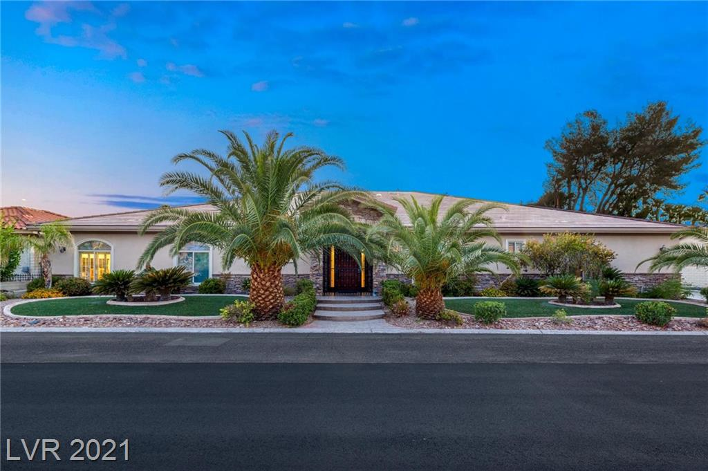 This tastefully designed single-story home has NO HOA and is conveniently centrally located close to the world famous Las Vegas Strip and just minutes from the airport. Sprawling space is just under 5,000 square feet, has 4 bedrooms (with a possible 5th), 4.5 bathrooms, inviting theater room, and 3 car garage. Spectacular interior includes crown molding, stained concrete flooring in all high traffic areas/carpeting in bedrooms, spacious living room with wet bar and more.  Delightful kitchen will satisfy the fussiest of gourmet chefs. Stainless steel appliances, walk-in pantry, espresso/cafe machine, custom cabinets and granite counters w/ tremendous island.  Family room features stacked stone fireplace and hardwood built-in entertainment center. Three of the spacious en-suite bedrooms have walk-in closets. Built in aquarium. Entertainers dream backyard features a refreshing pool (w/ diving board) and spa, built-in BBQ and (half) basketball court.