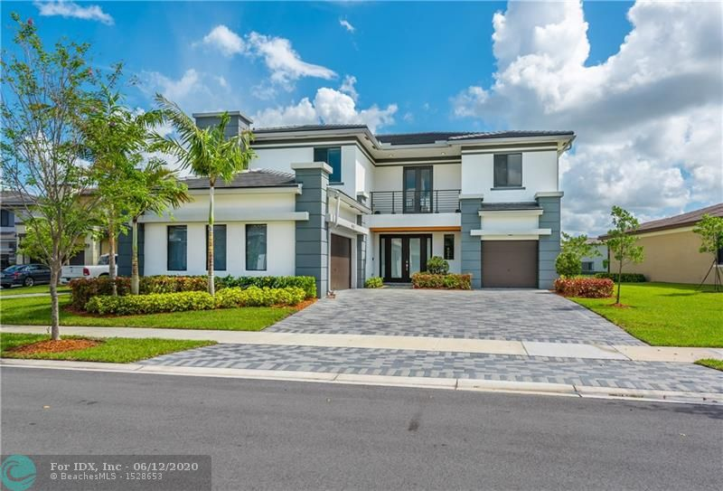Stunning, enhanced Ruby model in the Cascata at Miralago Community. This home is just one year old and sits on an oversized lake lot. The kitchen has a large island, built in Keurig coffee maker and natural gas stove. The first floor has a formal living room and dining room, informal living area, game room and one bedroom with a cabana bathroom. Upstairs has a master suite plus three bedrooms, all with walk-in closets. Porcelain tile and wood flooring in common areas and carpet in the bedrooms. Tankless hot water heater. Conveniently located near the clubhouse to enjoy amenities such as tennis, resort-style swimming pool, basketball courts and much more!