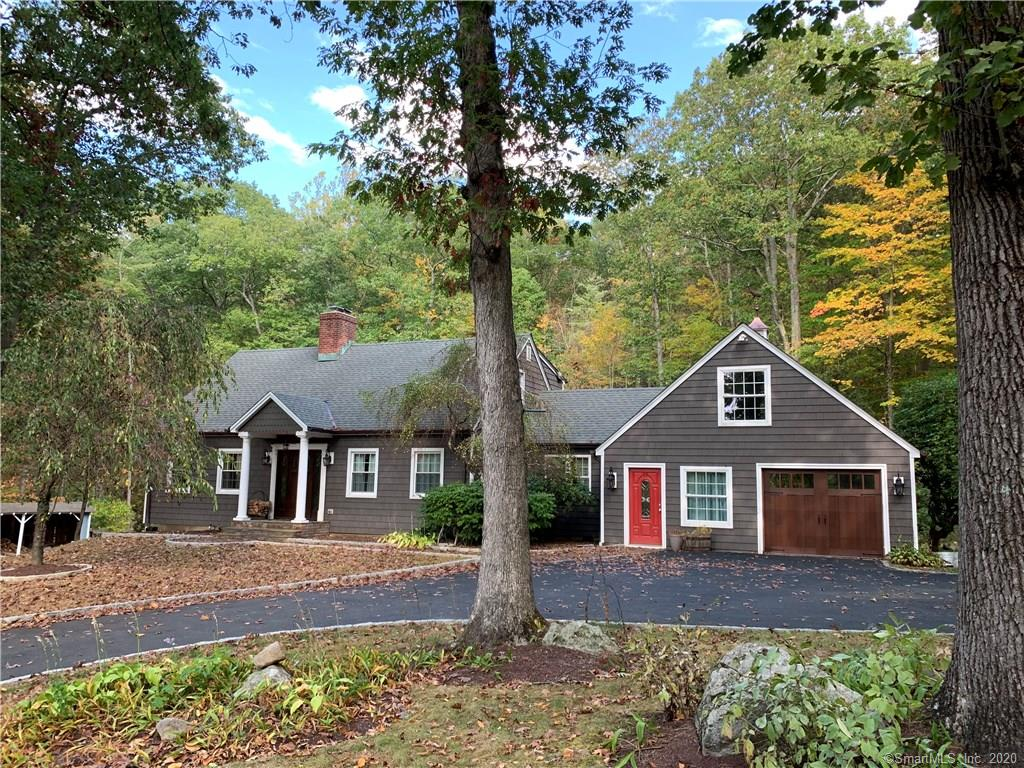 Great curb appeal and a great location.   This spectacular home sits on 1.07 acres but it abuts Connecticut's largest municipal park.  Tarrywile municipal park consists of 722 acres with over 21 miles of hiking trails, 2 ponds, a lake and several picnic areas. Enjoy the convince of being only a few miles from downtown Danbury yet having the country feeling this location provides.  The home has been tastefully updated and boasts refinished hardwood floors, custom built-ins, large deck, new siding and a spectacular eat-in-kitchen with large center island, Cambria and Quartzite counters, a farm sink and new appliances. Not included in the square footage is the newly finished studio space above the garage.  There is also a large equipment shed and a Generac Standby house generator included in this offering.