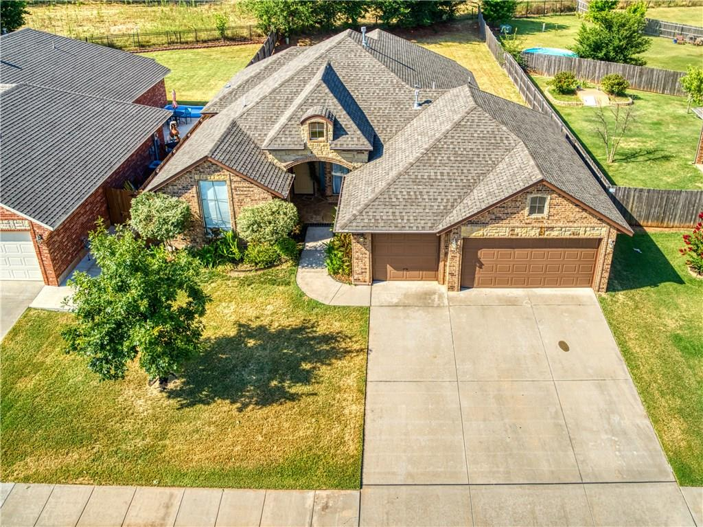 Hard To Find: Lots of upgrades made by Builder for his personal friend, the original Buyer of this home.  Will need to see to appreciate.  Home has a 5 car attached garage with an overhead garage door leading to a large back yard.  Seller to replace the stainless steel kitchen stove prior to closing.