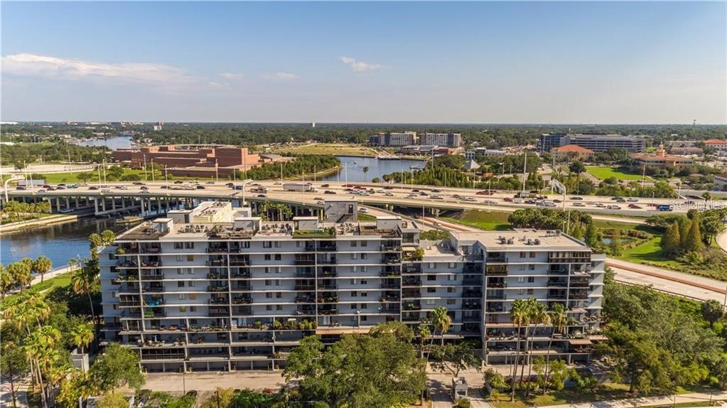 WELCOME to this magnificent corner penthouse unit at One Laurel Place! With 360 degree views of Tampa & beyond this is surely a unit you do NOT want to miss. Situated in the rapidly growing area of downtown Tampa this unit features open concept living with a split floor plan with 4 bedrooms, & 2.5  bathrooms, & THREE oversized outdoor living spaces! As you walk into the unit you will be greeted with french doors, high ceilings & and an open floor plan which allows comfortable living & the perfect feng shui between the living, dining, & kitchen areas. You have to admire the beautiful kitchen where you can cook your favorite meals or entertain all your guests. It features stainless steel appliances, & an oversized island that is perfect for entertaining. The owner's retreat is sure to please & has plenty of space for your king sized bed! Here you will find plenty of sunlight, a walk-in closet with built-in closet system, and an en-suite bath which features a walk-in shower with alluring stone work & double vanity. In this unit you will also find 3 additional sizable bedrooms, a guest bath, & a half bath for your guests to use. This unit also features a laundry area, central AC, hurricane shutters, & last but not least we cannot forget the THREE AMAZING outdoor spaces totalling over 1,400 SF of outdoor living space. You will not want to miss GOLDEN HOUR & relax on your vast covered balcony which spans OVER 25' long. Here, you can relax after a long day of work, enjoy that nice glass of wine that you've yearned for all day, & gaze at the riverwalk as the light reflects off the water during the early eve hours. Not feeling the balcony? Well that's ok! You can head take your beautiful spiral staircase upstairs & spend time on your HUGE rooftop deck where you can enjoy Tampa views from every angle! Have guests over & ready to party?! Head out to your OVERSIZED outdoor terrace which overlooks the Riverwalk & Julian B Lane Park which has 2 dog parks, tennis courts, workout s