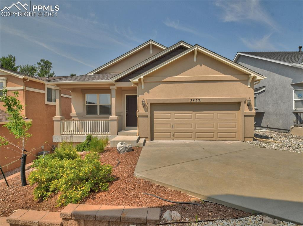 The perfect ranch style home in a quiet cul-de-sac in the desirable neighborhood, Parkside At Mountain Shadows. Sellers pride of ownership shows upon entering this spacious main level living with hardwood flooring throughout main level. Lots of light makes this such a warm inviting room with a peninsula gas fireplace separating the living and dining space. Kitchen with granite counter tops and great cabinet space, large pantry and access to covered trex deck with great views & plenty of room for a backyard barbeque. The main level master is the perfect size and has a 5 piece bath and large walk in master closet. The is also main level laundry room with washer/dryer included and 1/2 bath for company, entrance to garage from the laundry. The garden level basement has a large family room and two more bedrooms & full bath. There is plenty of storage space in this home as well. You are literally minutes from a walk in beautiful Mountain Shadows Park with full playground for the little ones and easy walk to Chipita Elementary School.. Minutes away from shopping, restaurants and lots of outdoor activities. Come take a look and fall in love with this perfect sweet home!