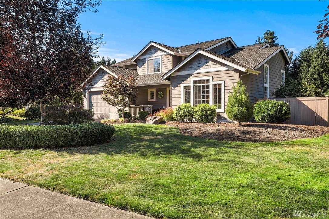 Updated home with stunning outdoor room. Vaulted ceilings fill the gracious living room with light. Updated kitchen with Shaker cabinets, slab granite counters, gas range, stainless appliances, pantry. Spacious family room. Vaulted master bedroom. Elegant master bath with deep soaking tub, dual sinks, stone accents. Half-acre lot and beautiful yard with large outdoor room for summer barbecues. Welcome home!