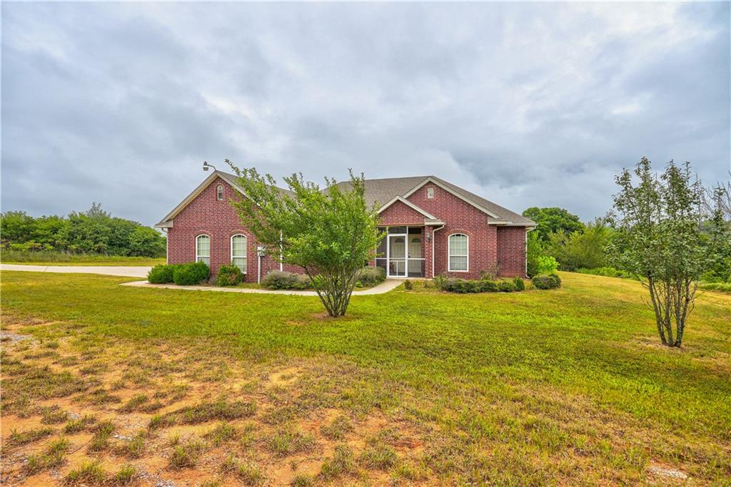 25 Acres! Beautiful and peaceful living in Oklahoma City.  4 bedroom spacious home with fireplace. Screened in porch and patio to relax and enjoy the country.  Come make this secluded home tucked away on 25 acres your own special haven.